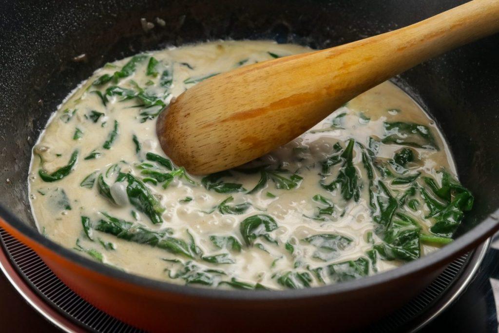 Add spinach and heavy cream