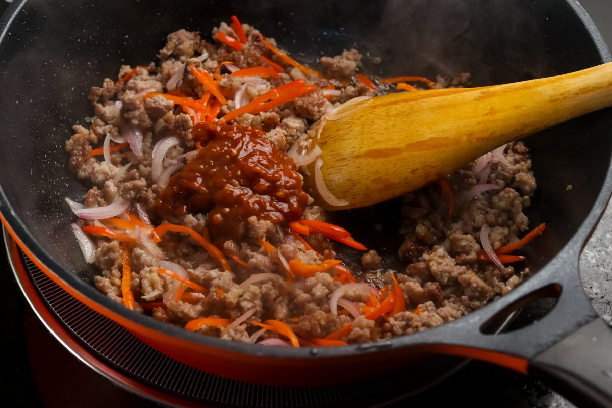 Add chili-blackbean paste. Stir well.