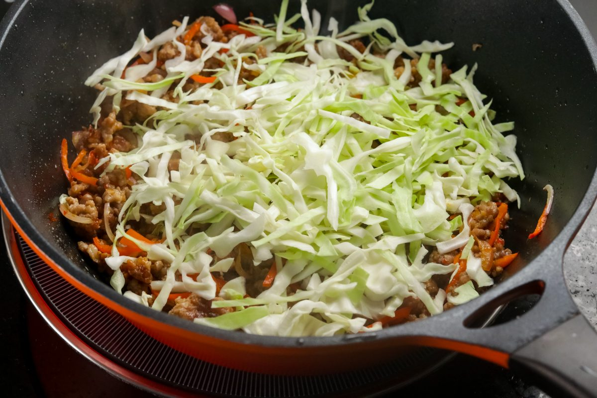 Add cabbage and toss for 1-2 minutes.