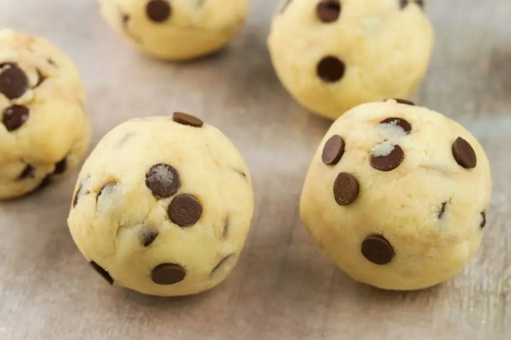 Divide the dough into balls and gently flatten it into shape.