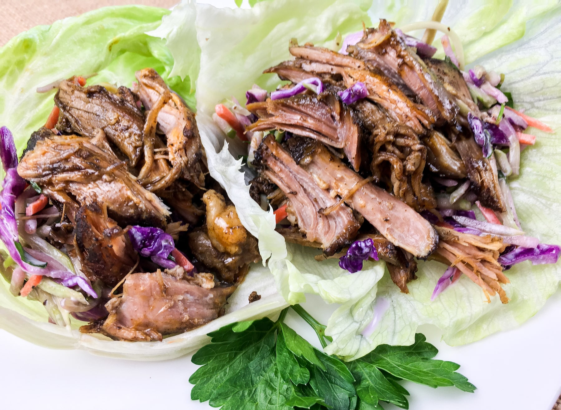 To serve, fill each lettuce leaf with some easy crunchy broccoli slaw and top with some pulled pork