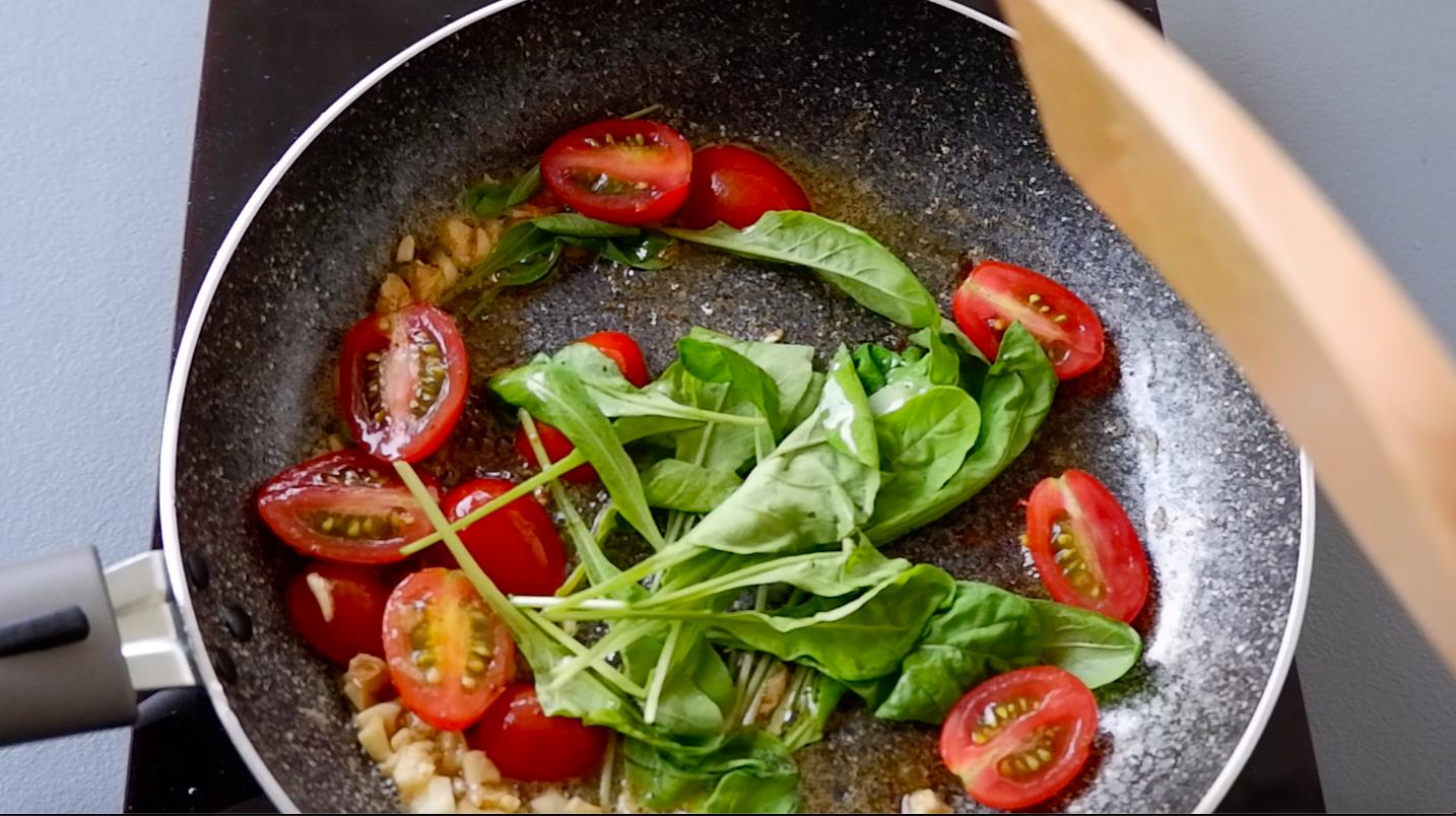 Add cherry tomatoes and arugula. Then, sprinkle with salt and pepper. Cook until tomatoes are tender and arugula is just wilted.